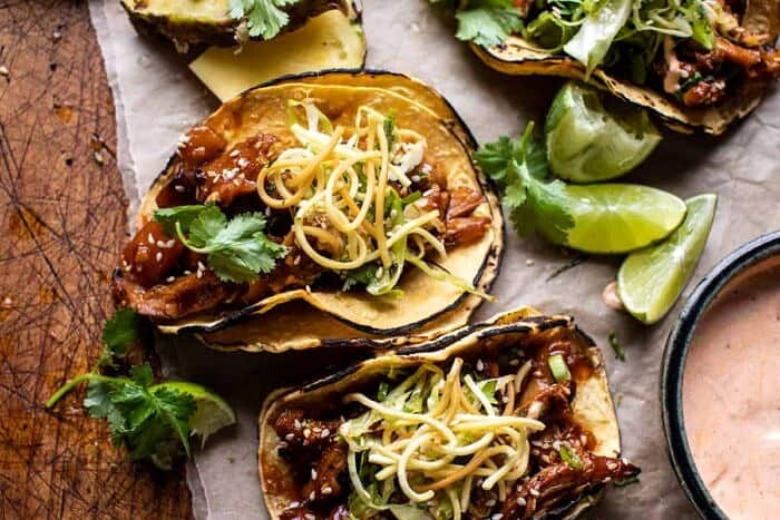 overhead horizontal photo of Slow Cooker Braised Hawaiian Pineapple Chicken Tacos
