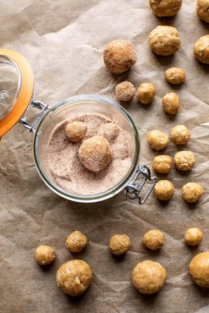 prep photo of rolling the dough balls in cinnamon sugar