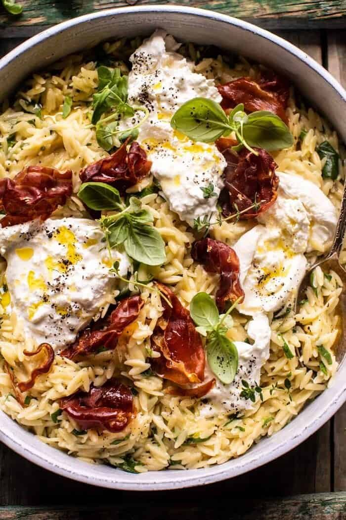 overhead close up photo of 20 Minute Orzo Carbonara with Crispy Prosciutto and Burrata