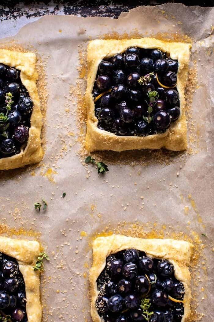 overhead prep photo of Bursting Blueberry Lemon Thyme Tarts on baking sheet before baking