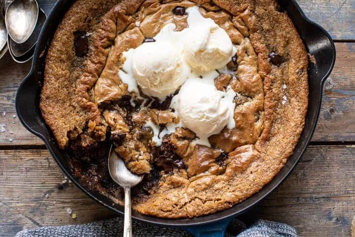 overhead horizontal photo of Crinkle Top Chocolate Peanut Butter Skillet Blondies with spoon in skillet