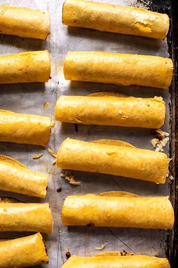 overhead prep photo of Chicken Tinga Taquitos before baking