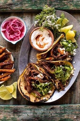 Crockpot Carne Asada Tacos with Cilantro Lime Garlic Sauce | halfbakedharvest.com