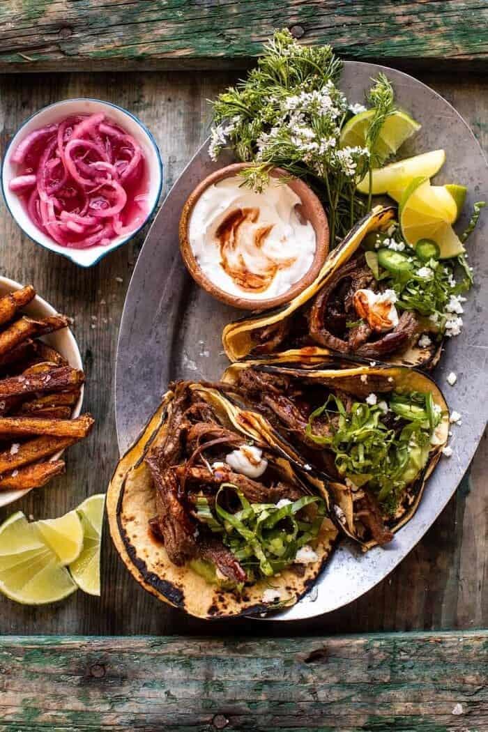 Crockpot Carne Asada Tacos With Cilantro Lime Garlic Sauce Half Baked Harvest