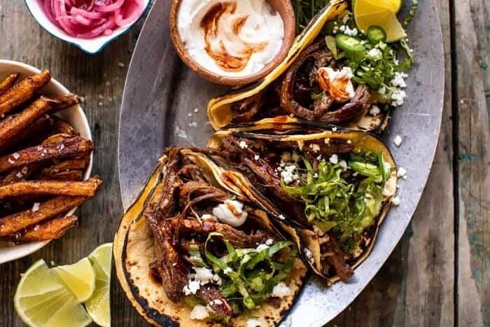 overhead photo of Crockpot Carne Asada Tacos with Cilantro Lime Garlic Sauce