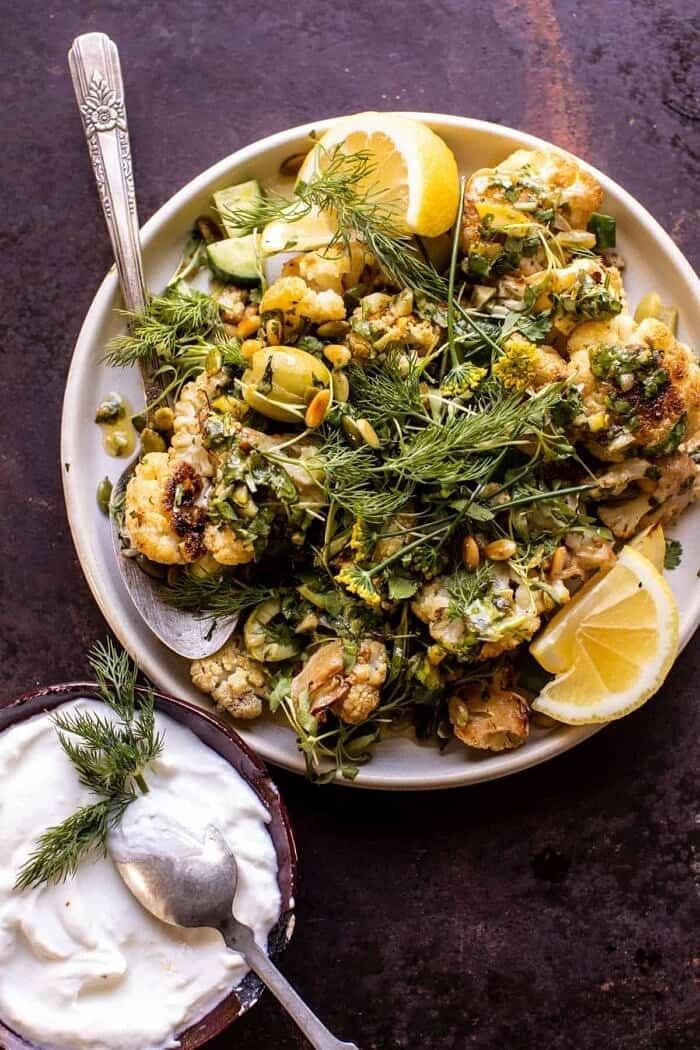 overhead photo of Charred Lemon Cauliflower and garlic yogurt