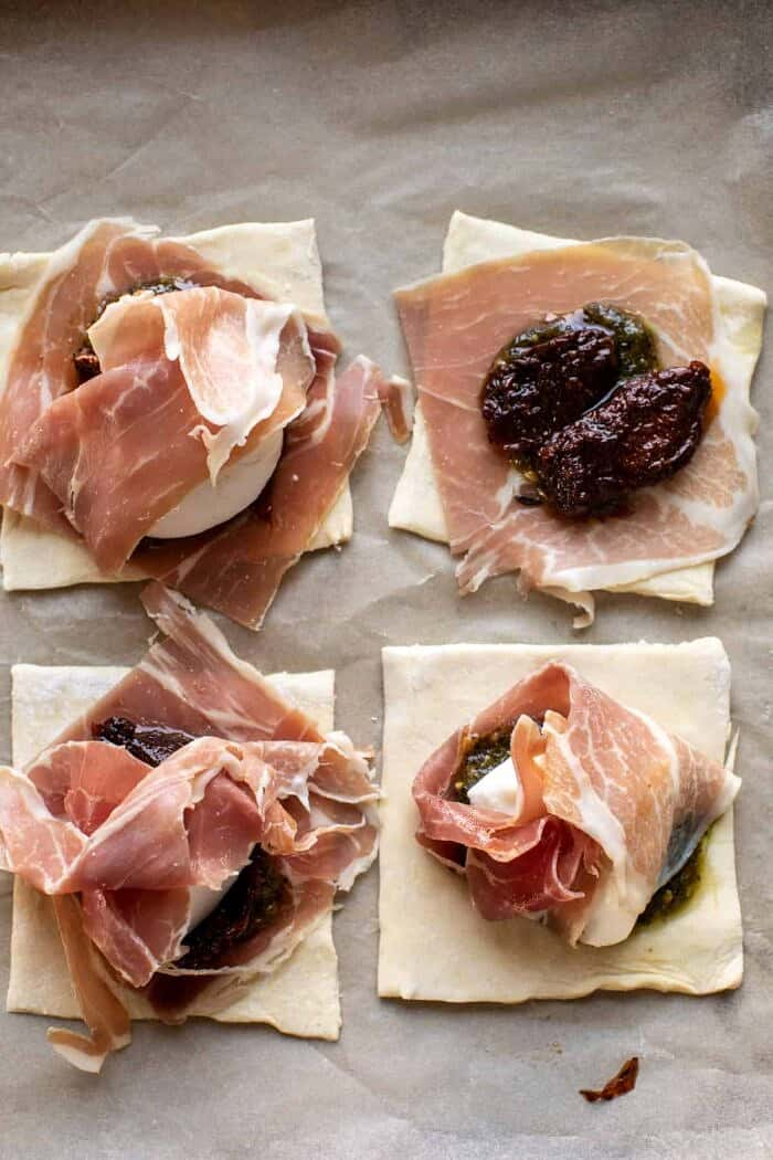prep photo of assembling Prosciutto Caprese Puff Pastries before baking