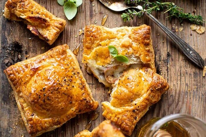 overhead horizontal photo of Prosciutto Caprese Puff Pastries with Peppery Thyme Honey