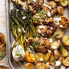 Sheet Pan Lemon Rosemary Dijon Chicken and Potatoes with Feta Goddess Sauce.