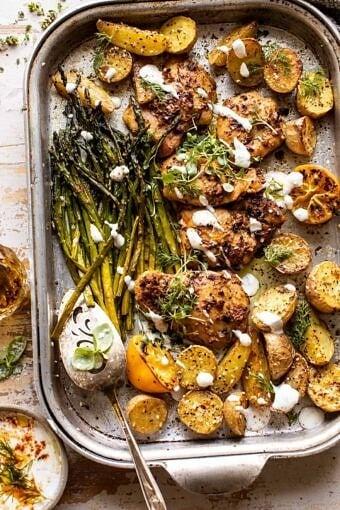Sheet Pan Lemon Rosemary Dijon Chicken and Potatoes with Feta Goddess Sauce | halfbakedharvest.com