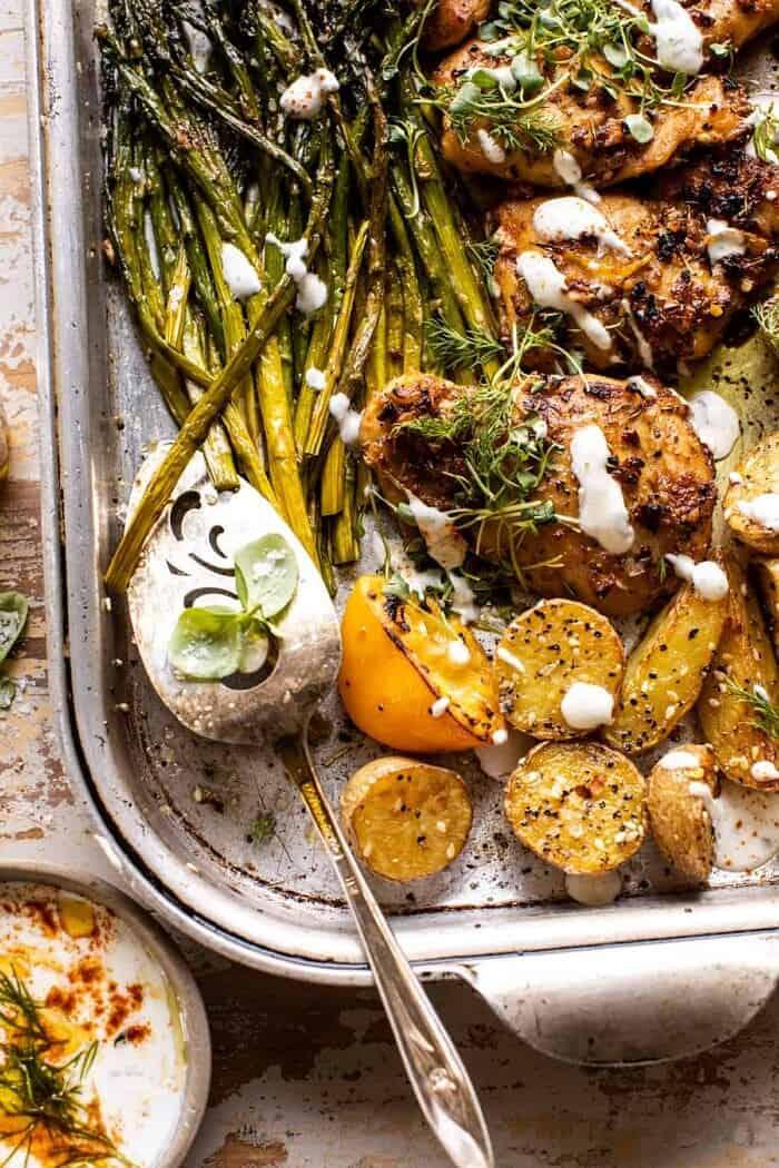 overhead photo of Sheet Pan Lemon Rosemary Dijon Chicken and Potatoes with Feta Goddess Sauce