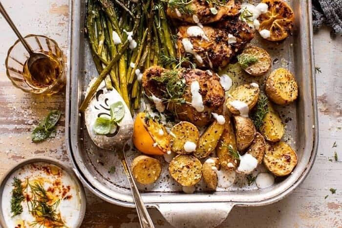overhead horizontal photo of Sheet Pan Lemon Rosemary Dijon Chicken and Potatoes with Feta Goddess Sauce