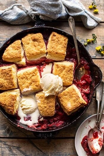Skillet Strawberry Bourbon Cobbler with Layered Cream Cheese Biscuits.
