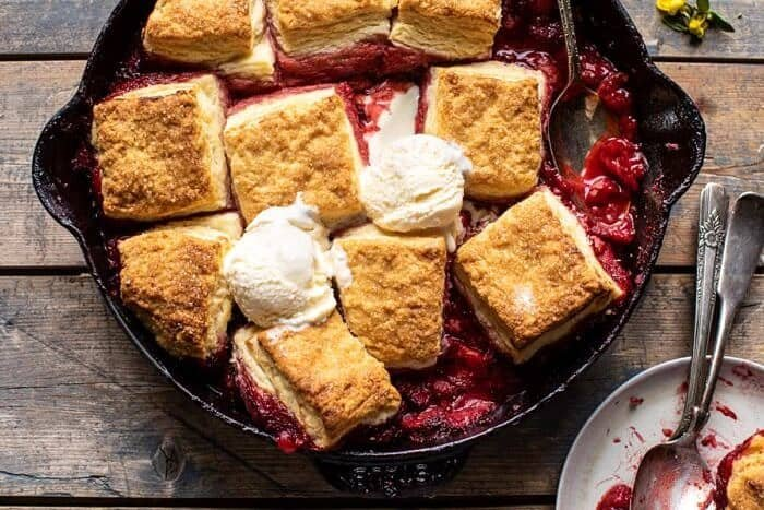 overhead horizontal photo of Skillet Strawberry Bourbon Cobbler with Layered Cream Cheese Biscuits