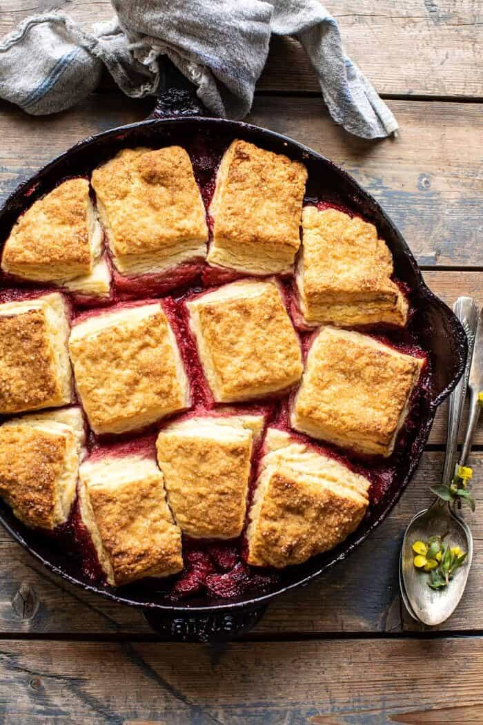 overhead photo of Skillet Strawberry Bourbon Cobbler with Layered Cream Cheese Biscuits