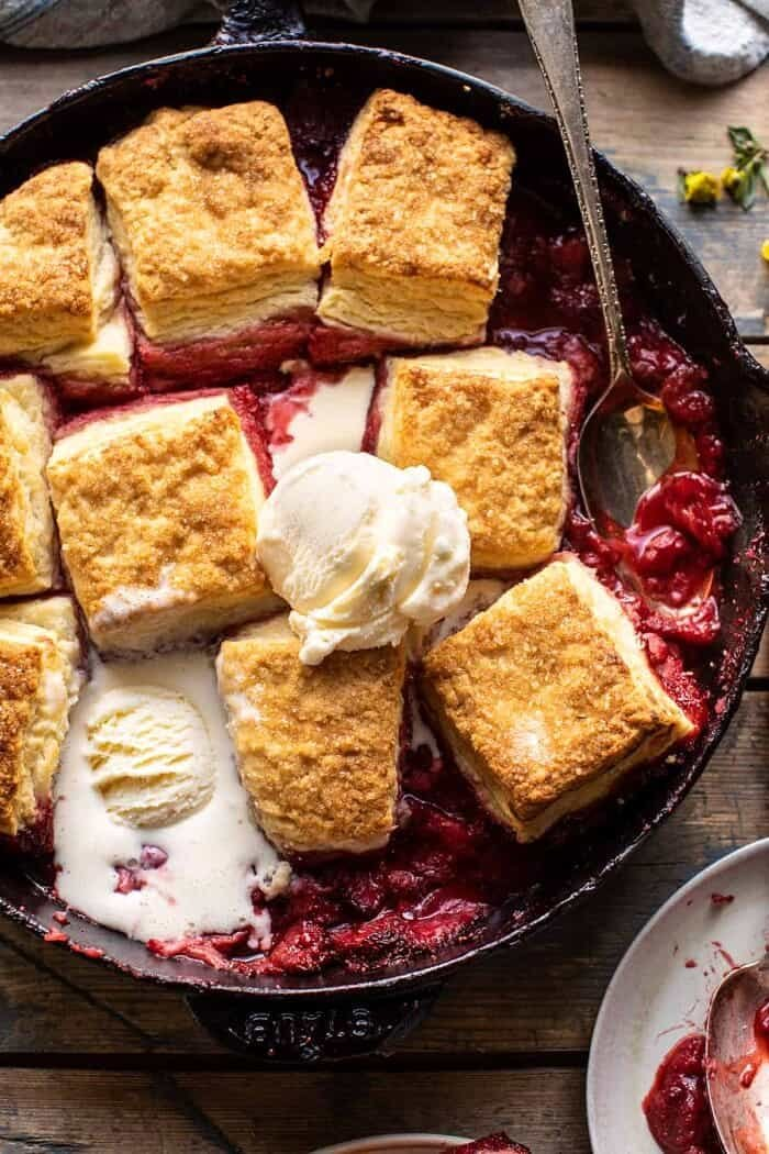 overhead close up photo of Skillet Strawberry Bourbon Cobbler with Layered Cream Cheese Biscuits