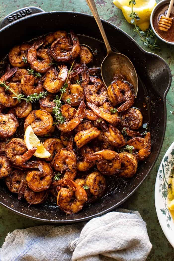overhead photo of 15 Minute Cajun Hot Honey Butter Shrimp in skillet with spoon