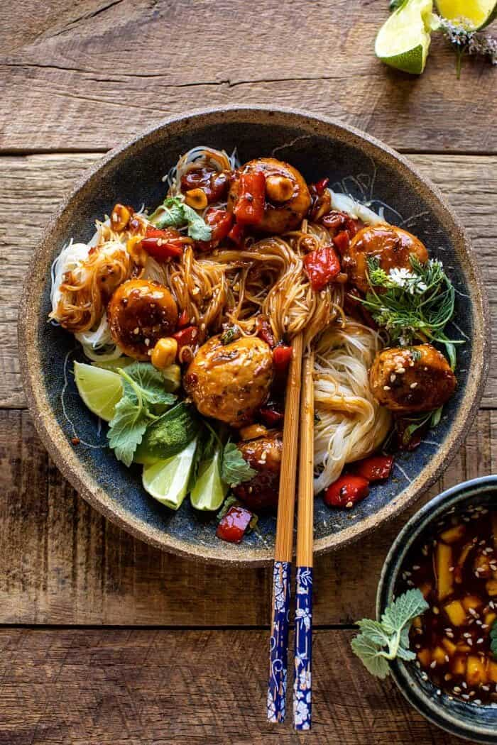 overhead photo of 30 Minute Sticky Thai Meatballs with Sesame Noodles with chopsticks in bowl