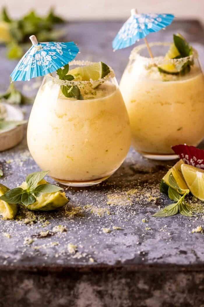 side angled photo of Basil Smash Piña Colada | halfbakedharvest,com