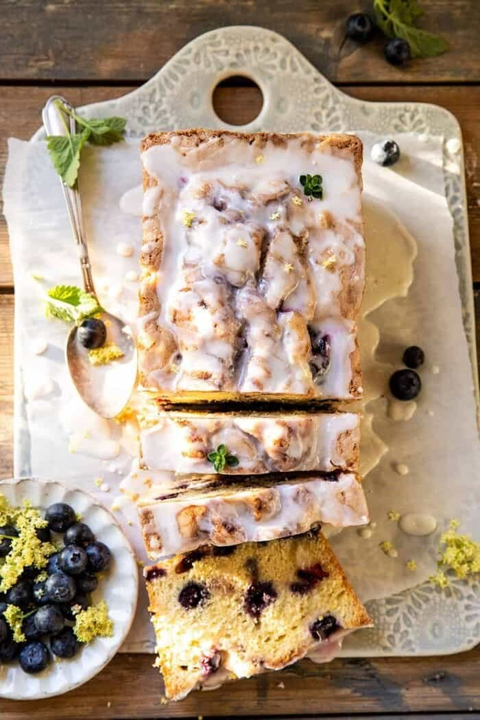 overhead photo of swirled Blueberry Lemon Thyme Cake with 3 slices of cake cut