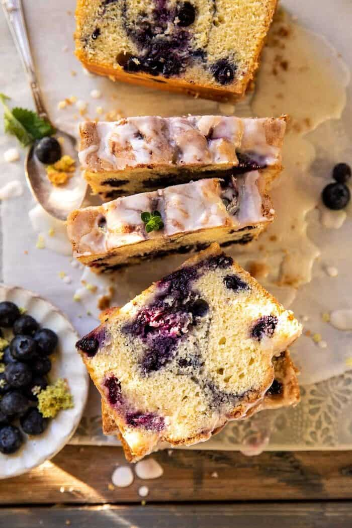 overhead close up photo of Blueberry Lemon Thyme Cake slices cut
