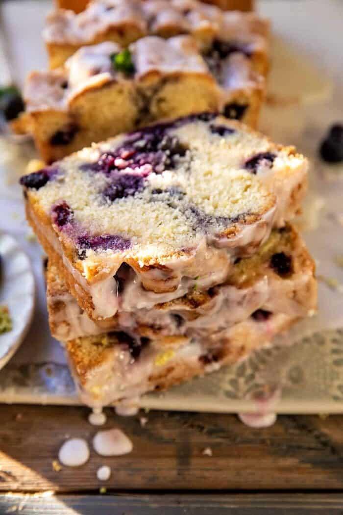 sided angled close up photo of Blueberry Lemon Thyme Cake | halfbakedharvest.com