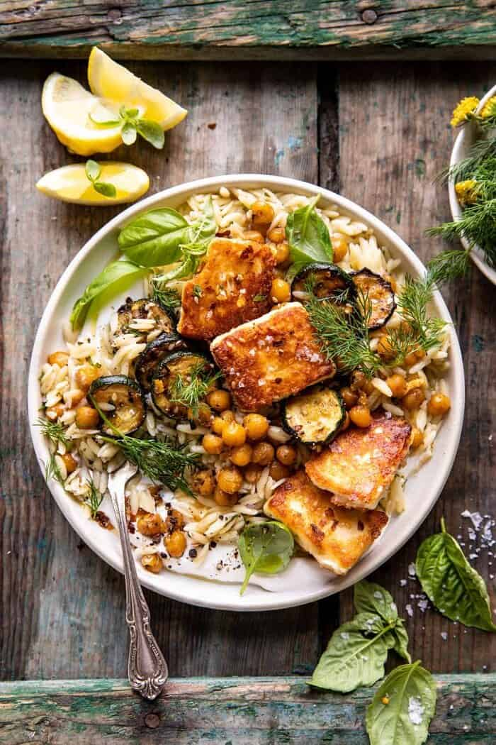 overhead photo of Crispy Lemon Feta with Spiced Chickpeas and Basil Orzo