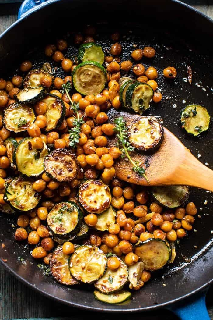 overhead photo of Spiced Chickpeas and zucchini in skillet