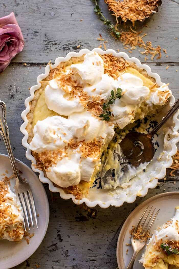 overhead photo of Lemon Sugar Coconut Cream Pie with 2 slices of pie cut and removed from pie
