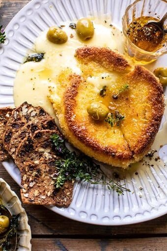 Pan Fried Brie with Peppered Honey and Olives | halfbakedharvest.com