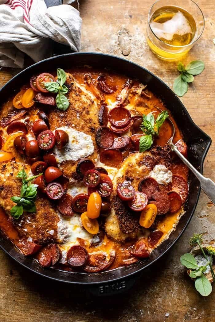 overhead photo of Skillet Cheesy Pepperoni Pizza Chicken with spoon in chicken