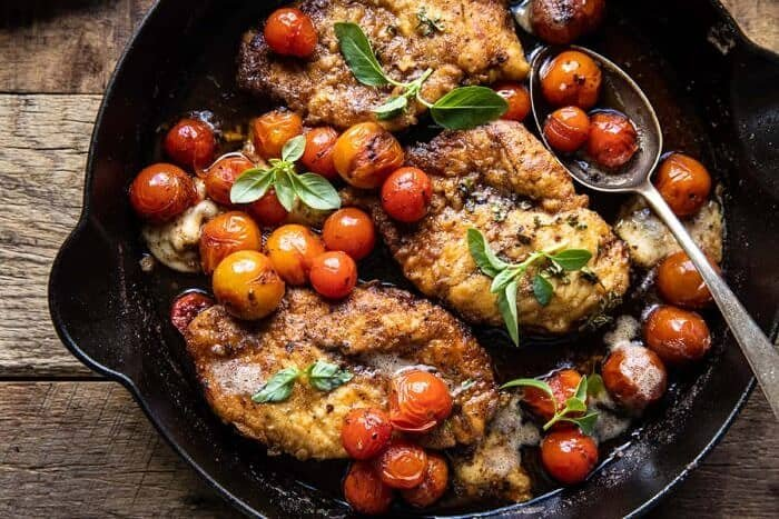 overhead horizontal photo of 20 Minute Florentine Butter Chicken with Burst Cherry Tomatoes