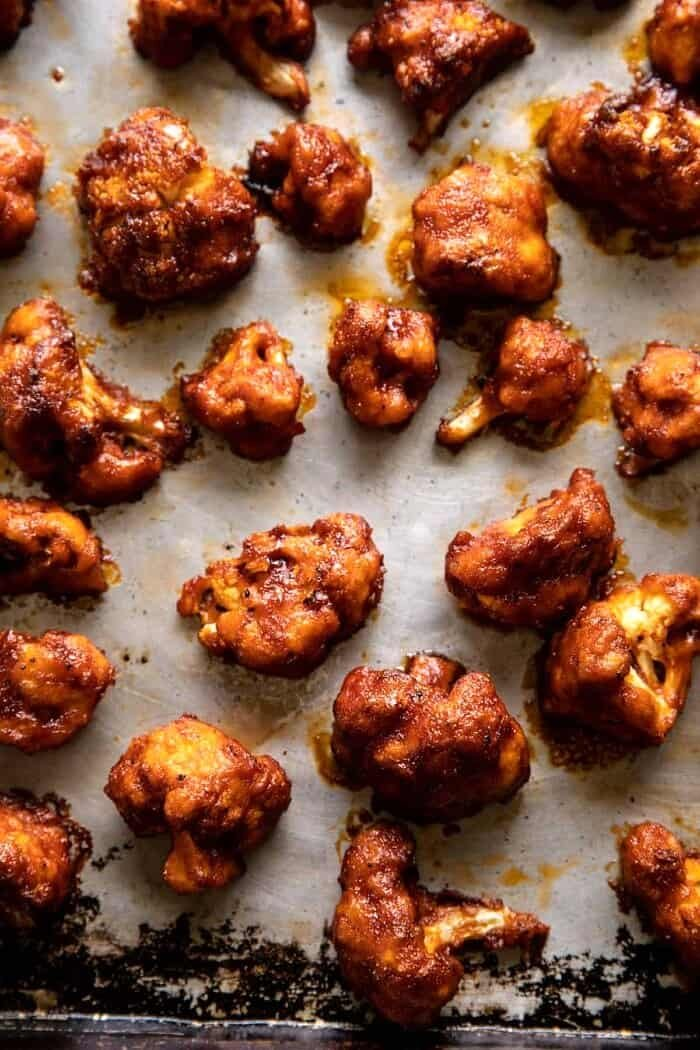 overhead photo of Crispy Beer Battered BBQ Cauliflower Nuggets on baking sheet after baking