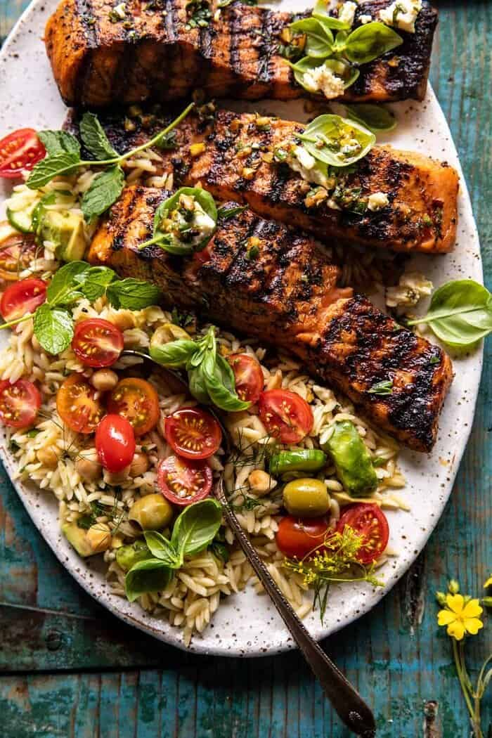 overhead close up photo of Greek Salmon with Lemon Feta and Orzo Summer Salad | halfbakedharvest.com