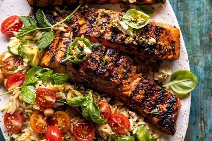 overhead horizontal photo of Greek Salmon with Lemon Feta and Orzo Summer Salad