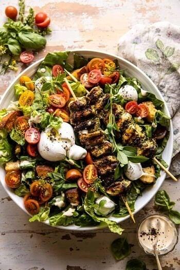 Pesto Chicken Caesar Salad with Tomatoes and Burrata.