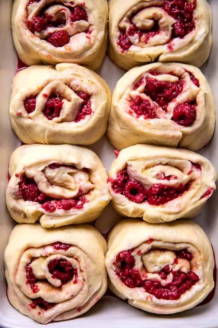 overhead photo of Raspberry Lemon Brioche Rolls in baking pan before baking