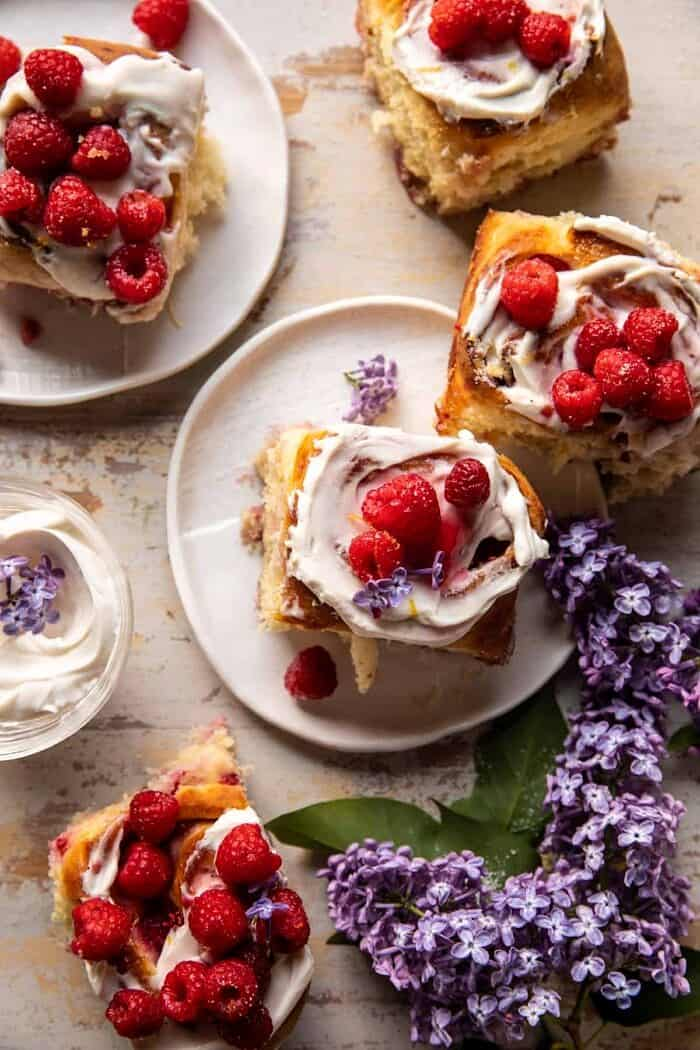 overhead photo of Raspberry Lemon Brioche Rolls with Whipped Ricotta Cream on plates