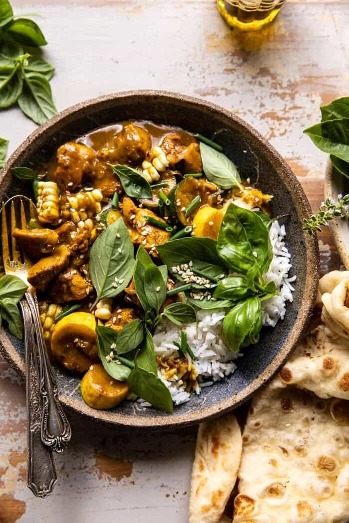 overhead close up photo of Spicy Coconut Basil Chicken Curry with Garden Vegetables