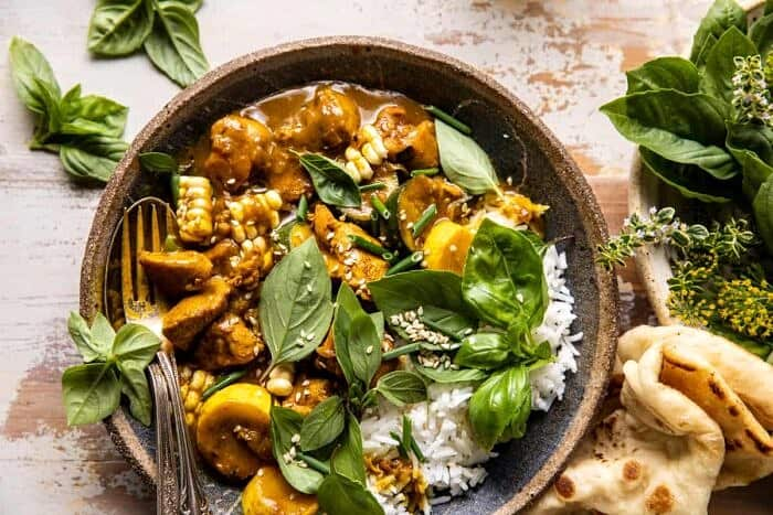 overhead horizontal photo of Spicy Coconut Basil Chicken Curry with Garden Vegetables