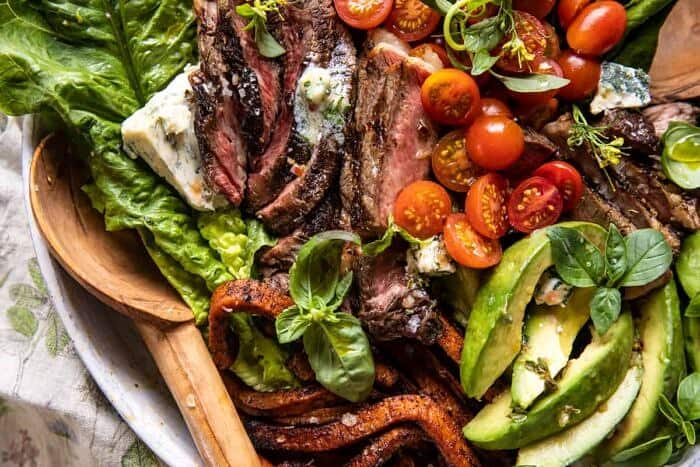 overhead horizontal photo of Sweet Potato Fry Steak Salad with Blue Cheese Butter