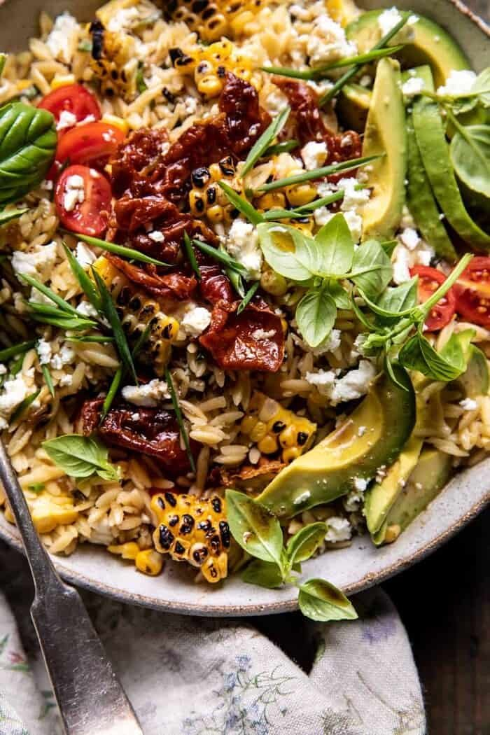 overhead close up photo of Brown Butter Corn and Feta Orzo with Crispy Prosciutto