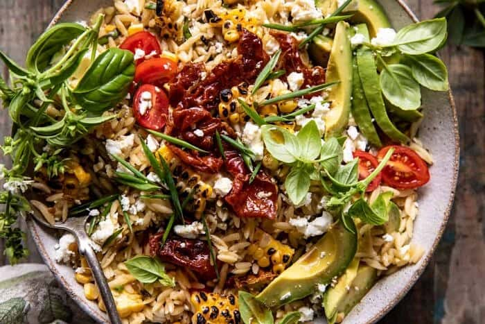 overhead horizontal photo of Brown Butter Corn and Feta Orzo with Crispy Prosciutto