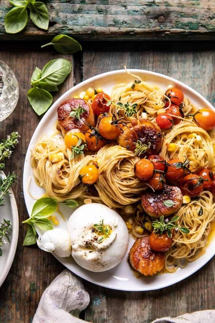 overhead close up photo of Browned Butter Scallops and Burst Tomato Basil Pasta with burrata