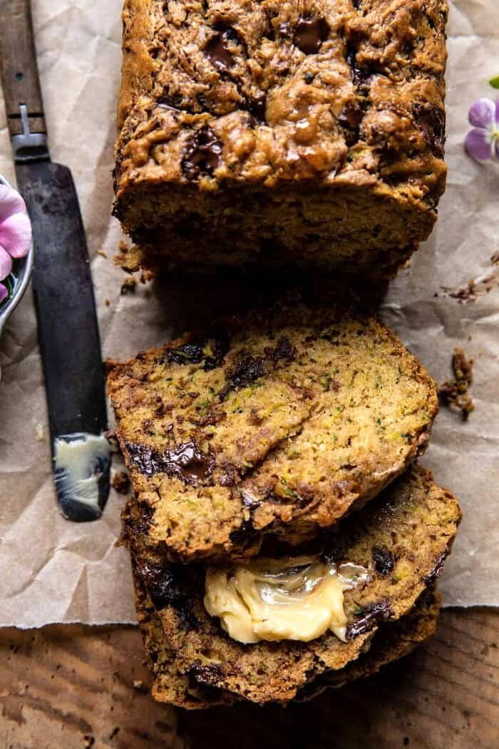 overhead photo of Chocolate Chunk Almond Butter Zucchini Bread with 3 slices of bread cut