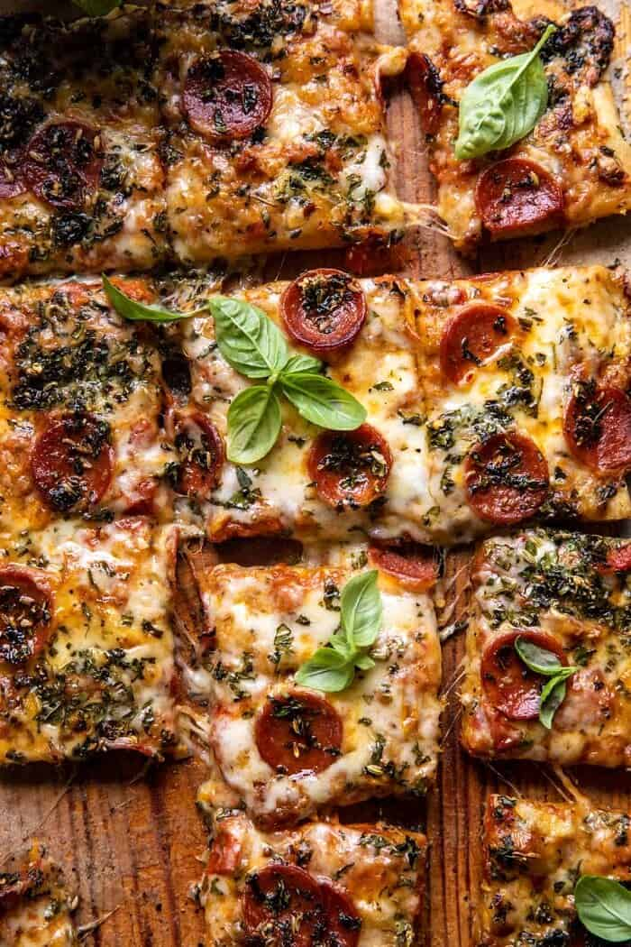 overhead close up photo of Easy Sheet Pan Tomato Herb Pizza