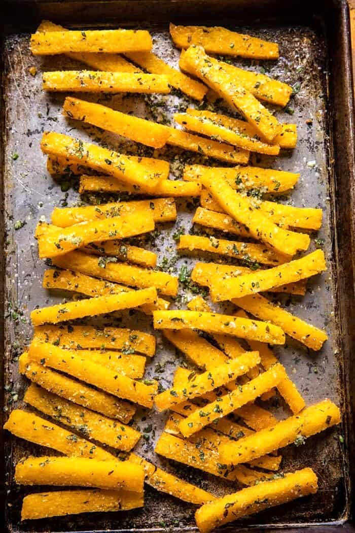 Garlic Parmesan Herb Butter Polenta Fries on baking sheet after baking