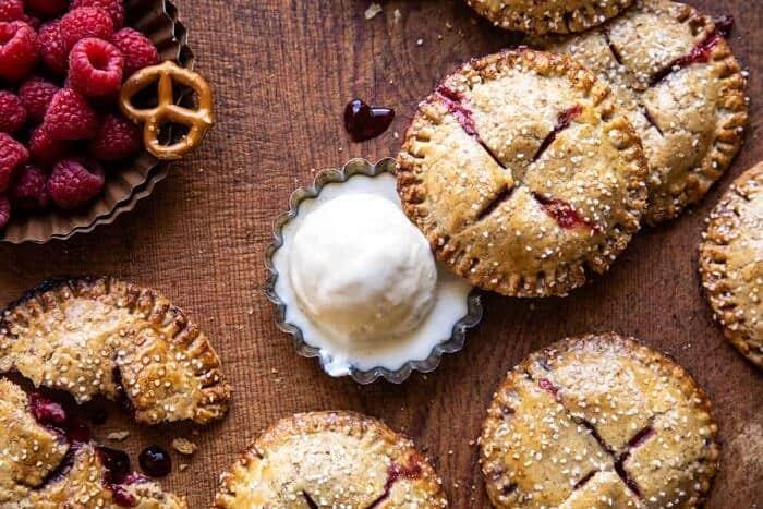 overhead horizontal photo of Jammy Raspberry Cream Pretzel Hand Pies