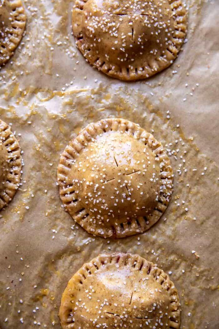 Jammy Raspberry Cream Pretzel Hand Pies before baking on baking sheet