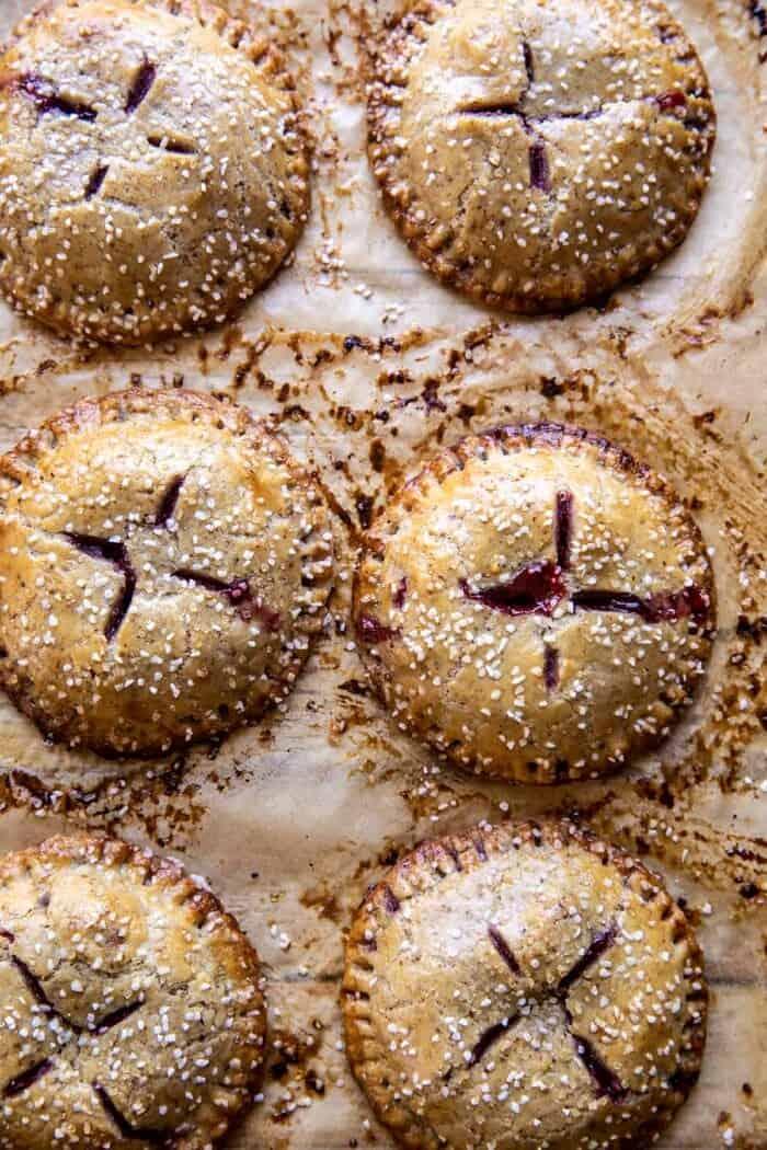 Jammy Raspberry Cream Pretzel Hand Pies after baking on baking sheet